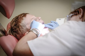 Photo of a kid at the dentist.