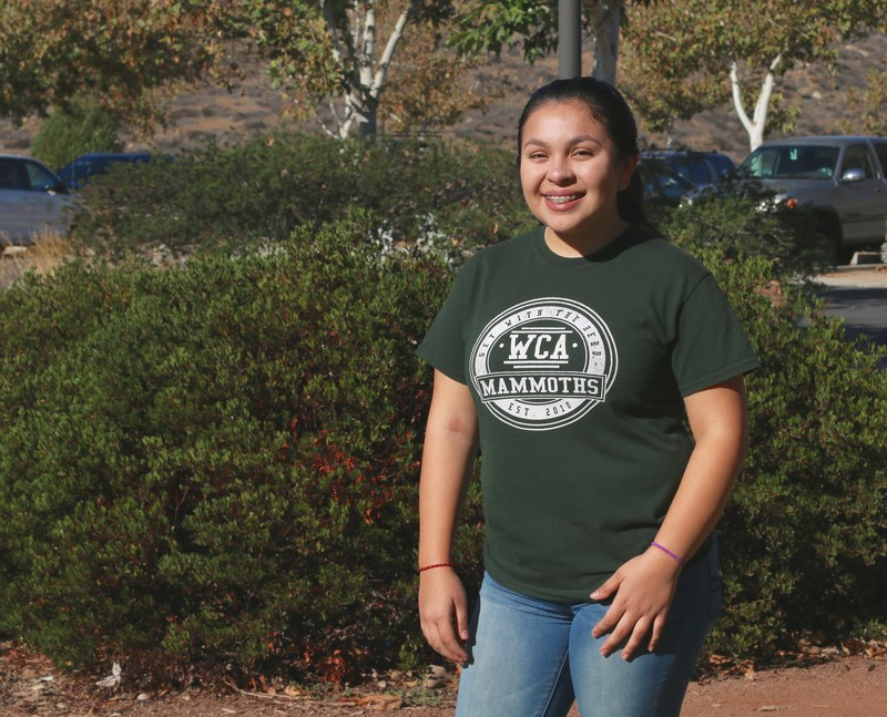 Isabella Martinez in front of Western Center Academy.