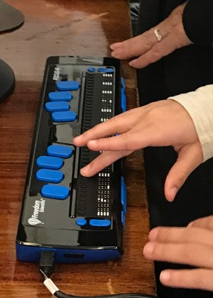 closeup of student with braille display