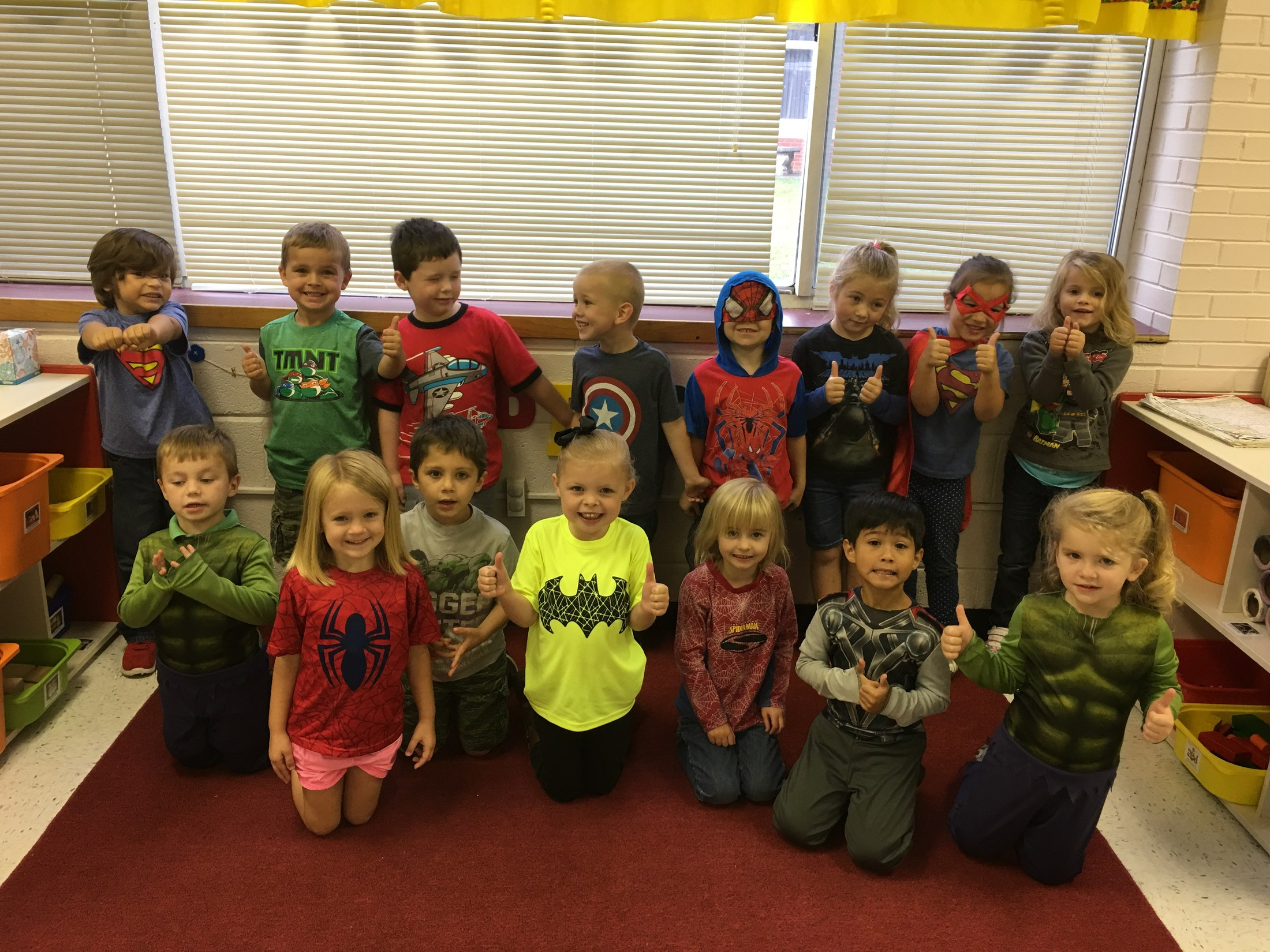 group picture of students dressed as superheroes
