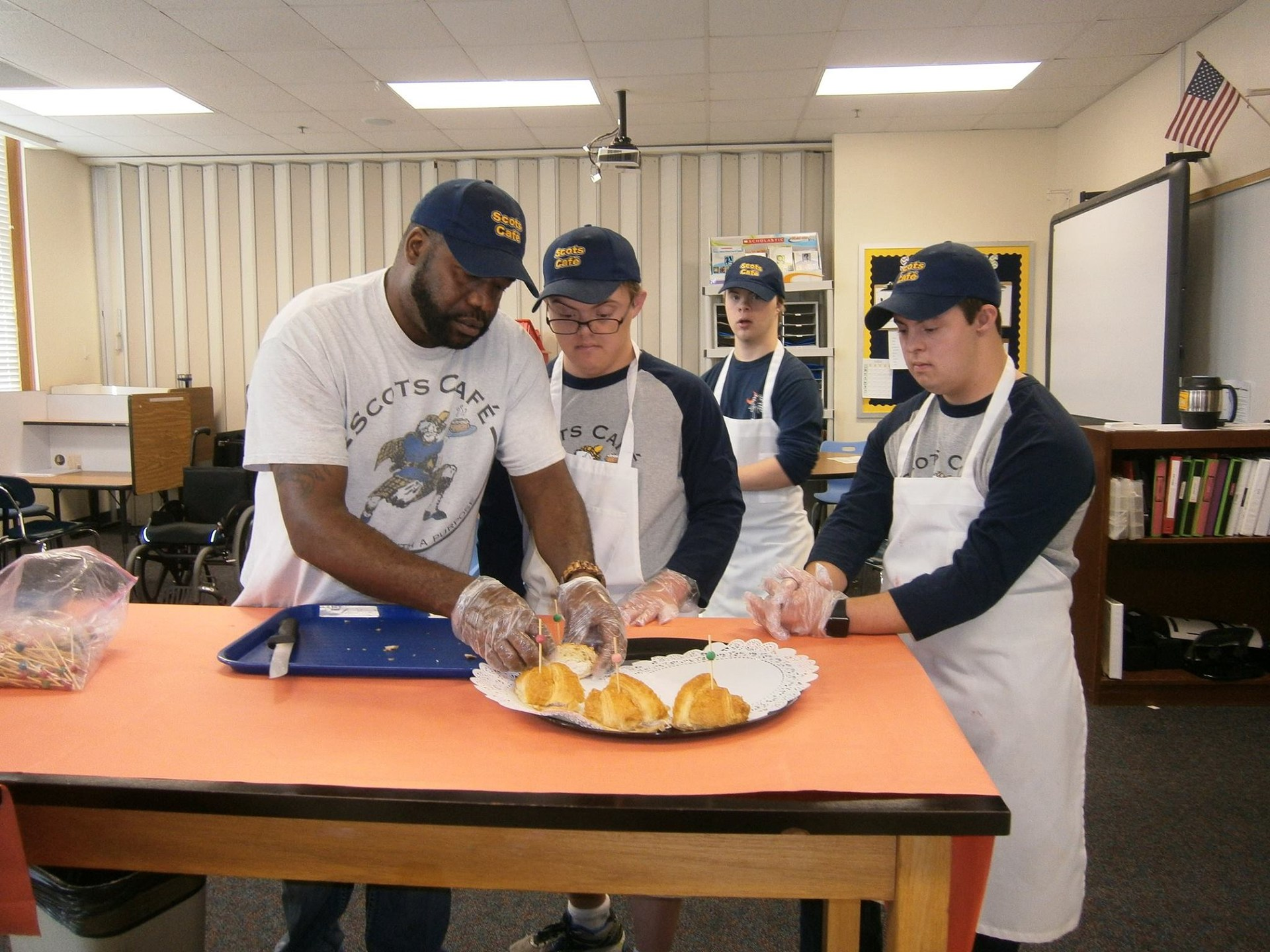 Scot's Cafe employees prepare loaves of fresh bread for an event.