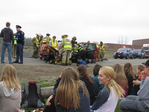 TKHS students watch a mock car accident to learn lessons about drunk or distracted driving.