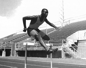 Clement seen jumping a hurdle during his high school years