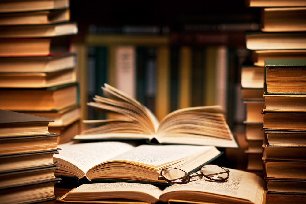 photo of books with glasses
