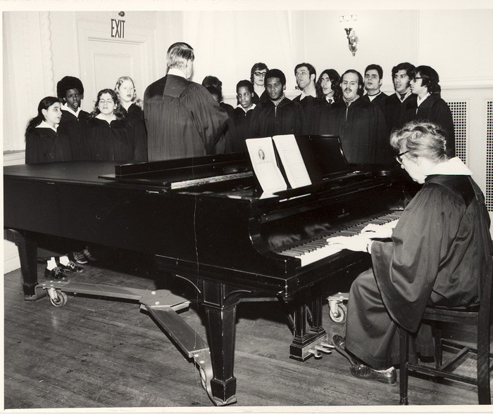 Mrs. Thode playing piano and rehearsing the choir