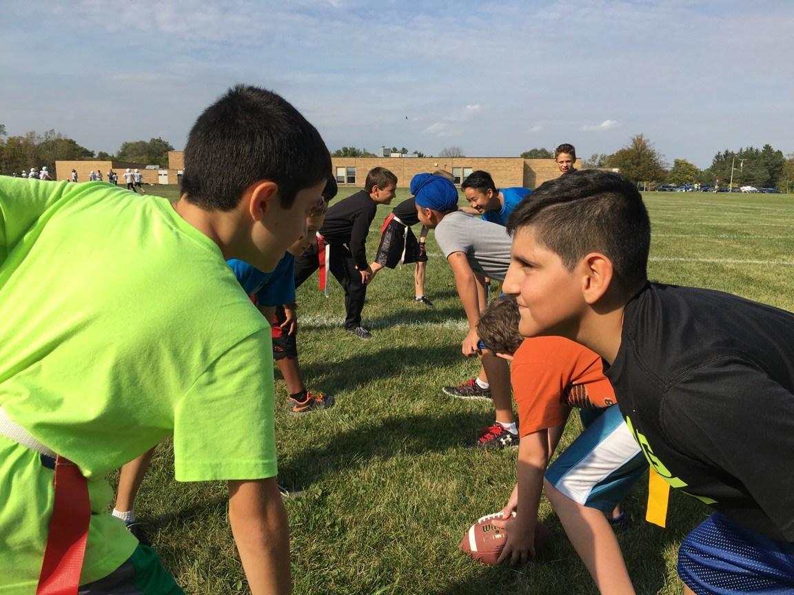 student playing flag football