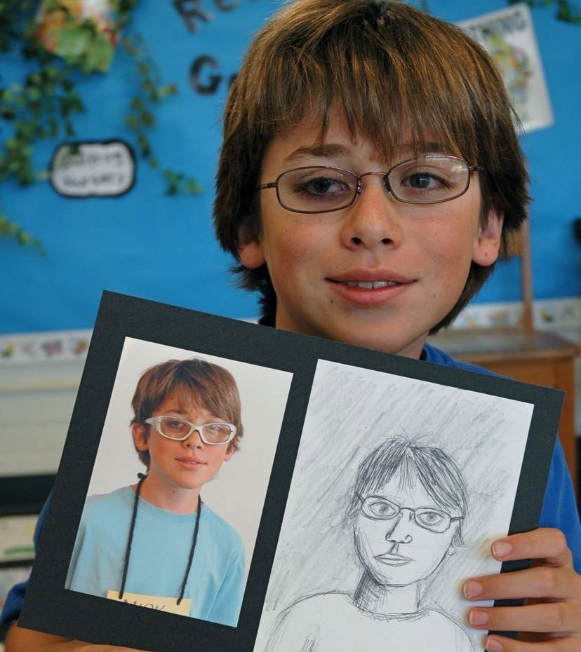 Student with self-portrait.