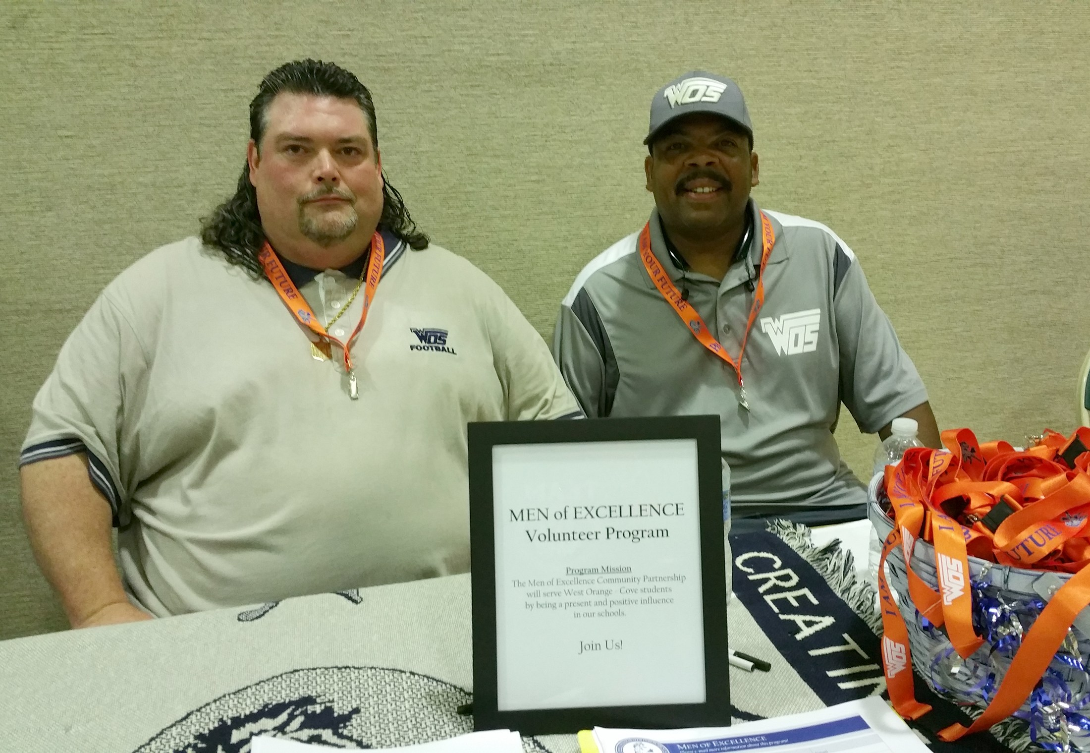 Men of Excellence work the Back to School Expo Booth at Lamar State College - Orange.