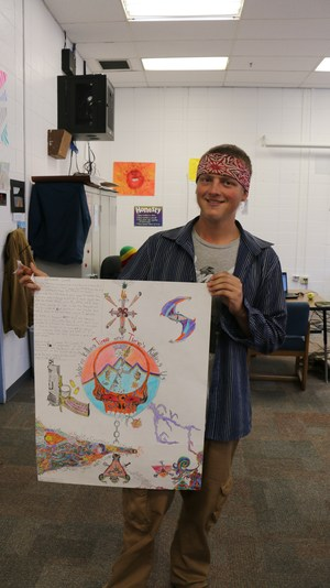Photo of Big Picture student holding up his artwork.