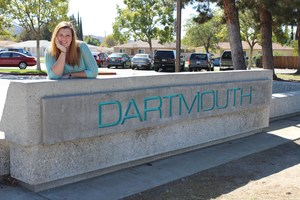 Heather Reynoso in front of the Dartmouth Middle School sign.