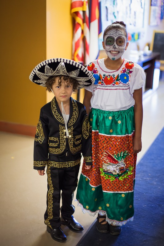students dressed in day of the dead or hispanic wear