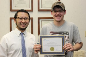 """Resident, Dr. Mark Takesuye and Vince on """"graduation day"""" from Wow Vision Therapy"""