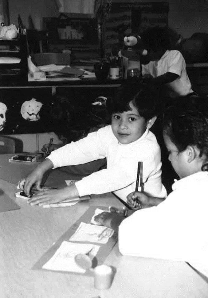 College Heights student enjoying an art project, 1997-1998.