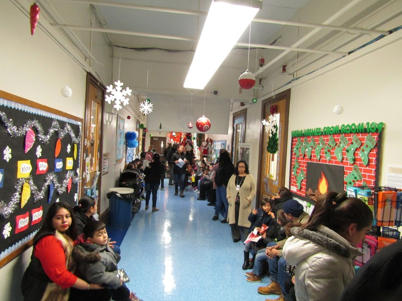 Parents in the hallways viewing students work and waiting for teachers