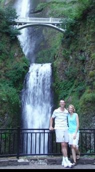 Picture of people in front of a waterfall