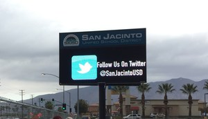 New LED sign with message showing Twitter icon and the account name for SJUSD.