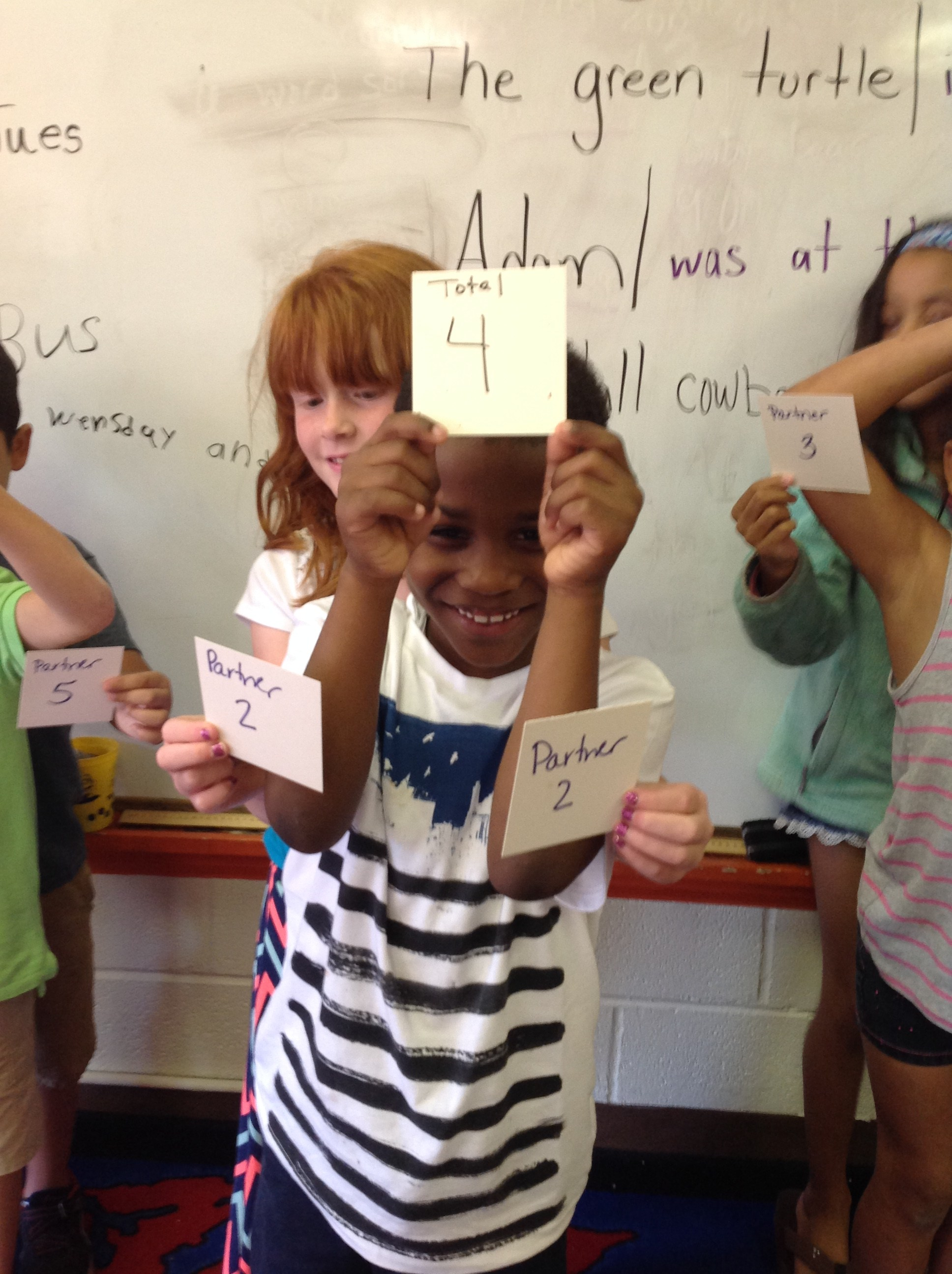 2 students with 3 number cards