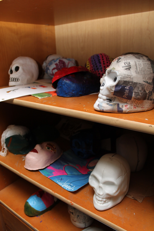 student artwork on shelf- paper mache masks