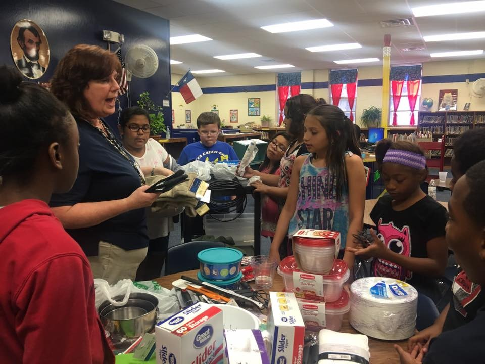 Cooking Club members sort kitchen utensils and supplies at their first meeting.