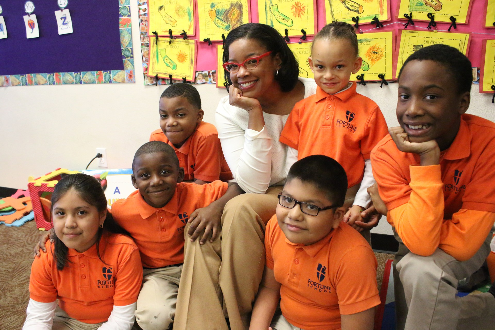 Margaret Fortune seated with Fortune School K-6 scholars.