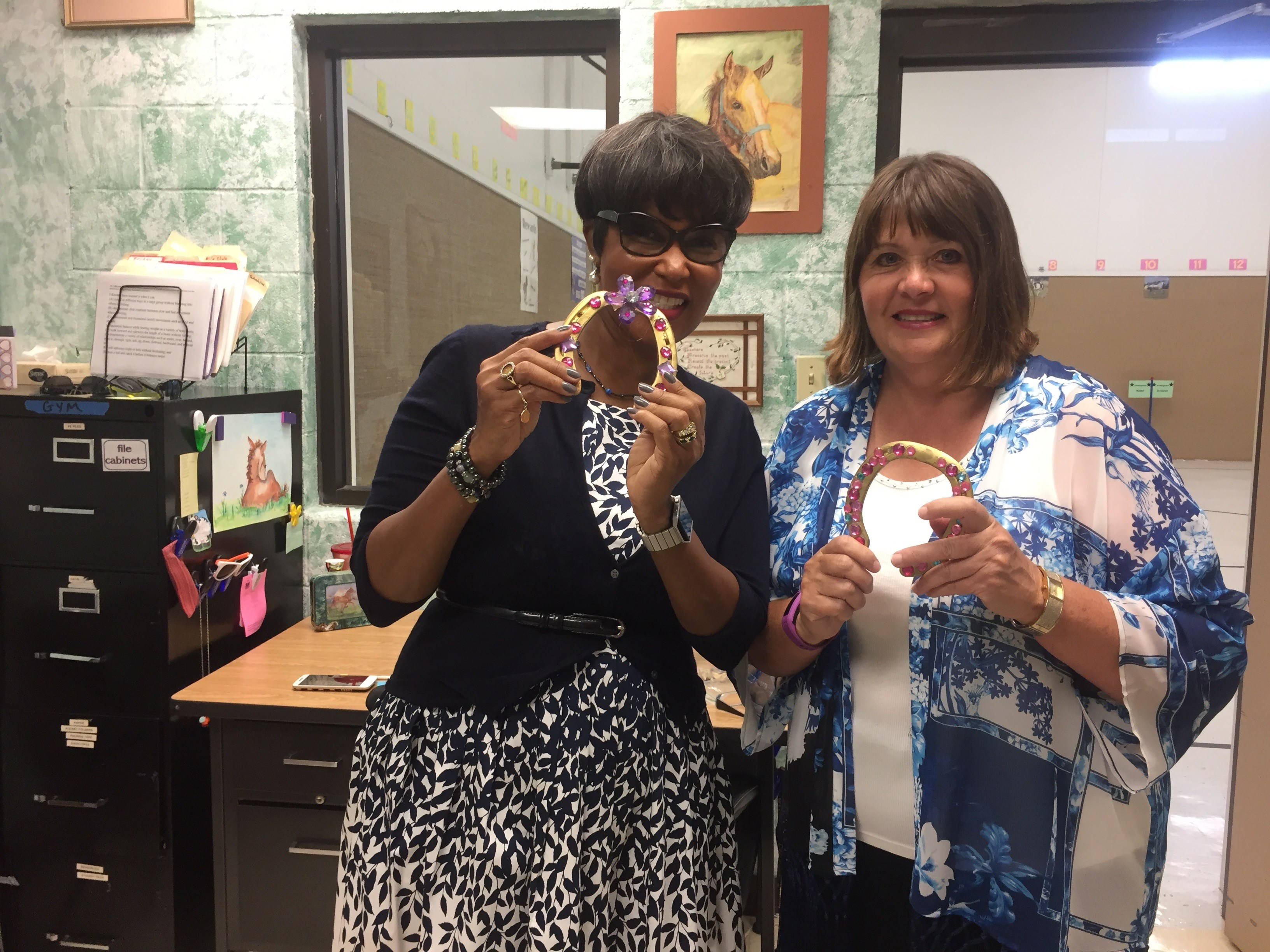 Dr. Sandra and Mrs Ford show off CTE's Golden Horseshoe