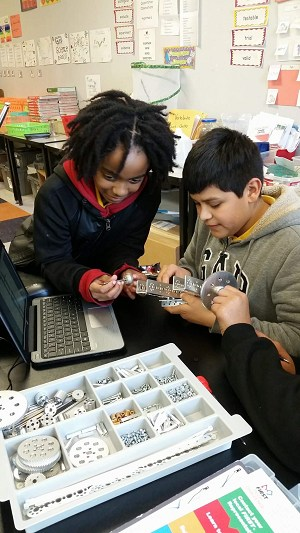 Students working with robot kit
