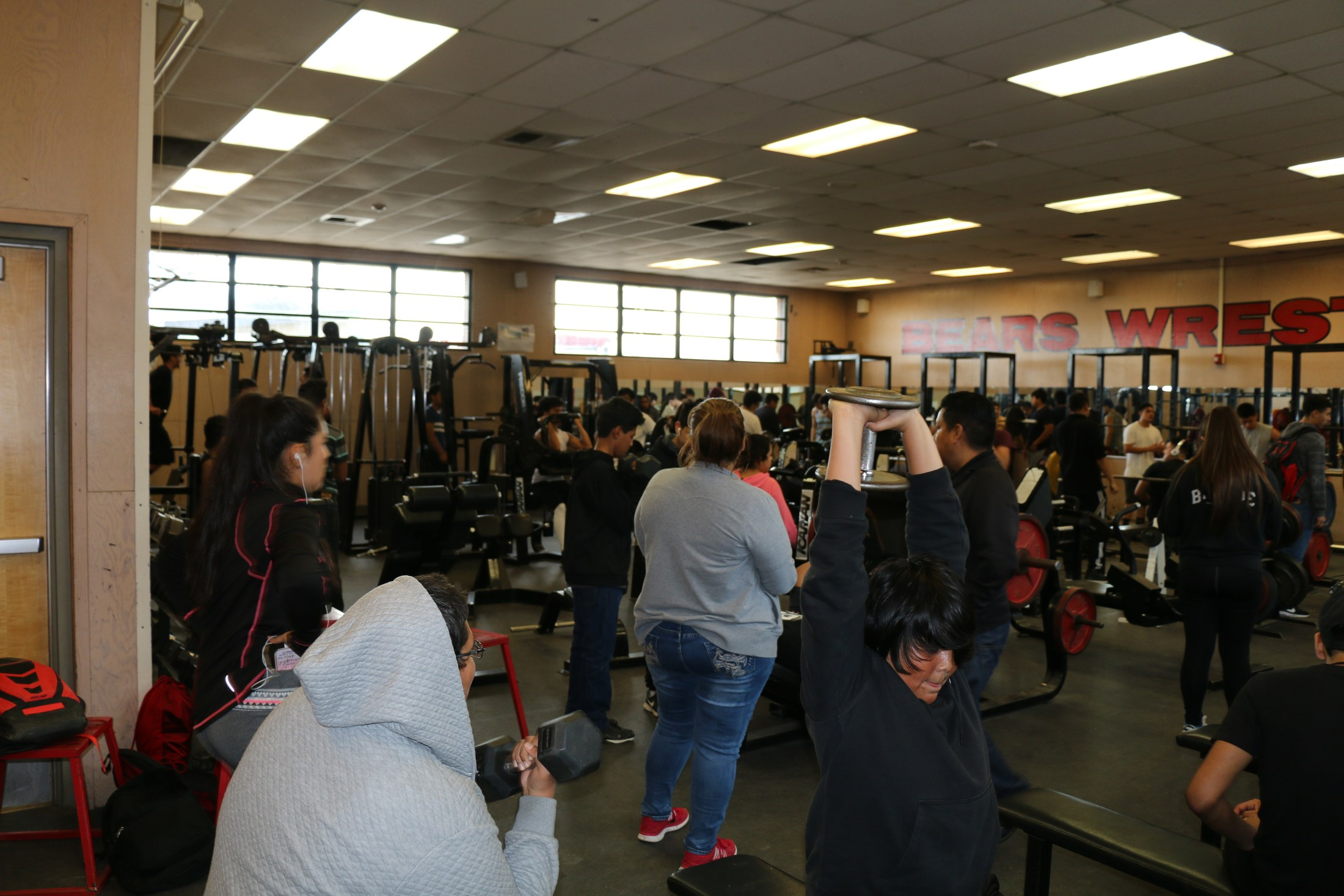 Arvin High students in the after school program lifting weights in the weight room.