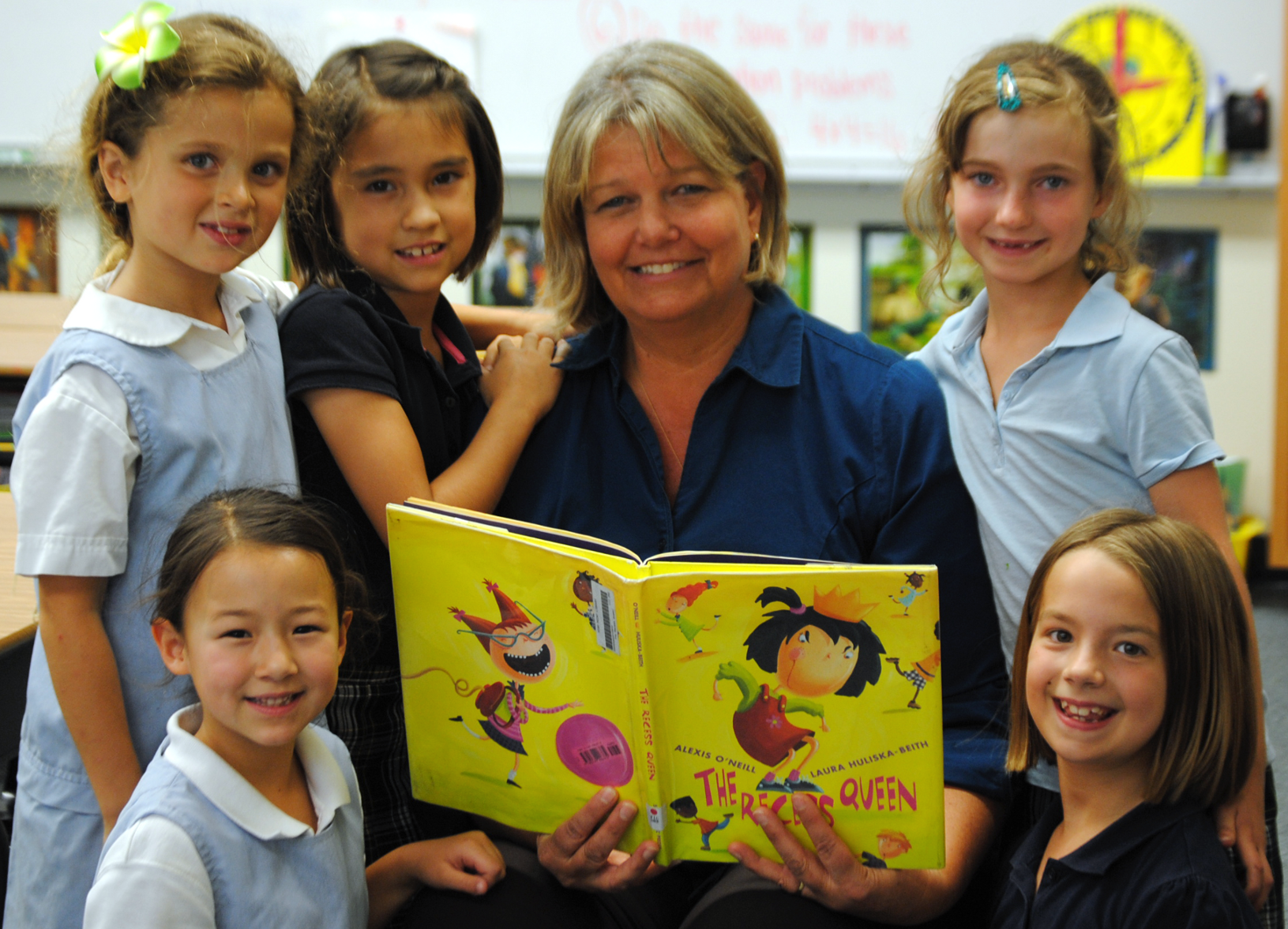 Kristin Haines reading to a group of students.