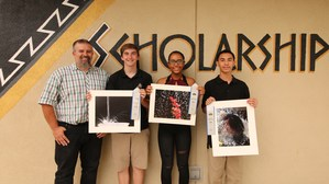 Mr. Robert Oliver, Nicholas Fox, Hannah Klos, and Christian Silva with their winning photographs.
