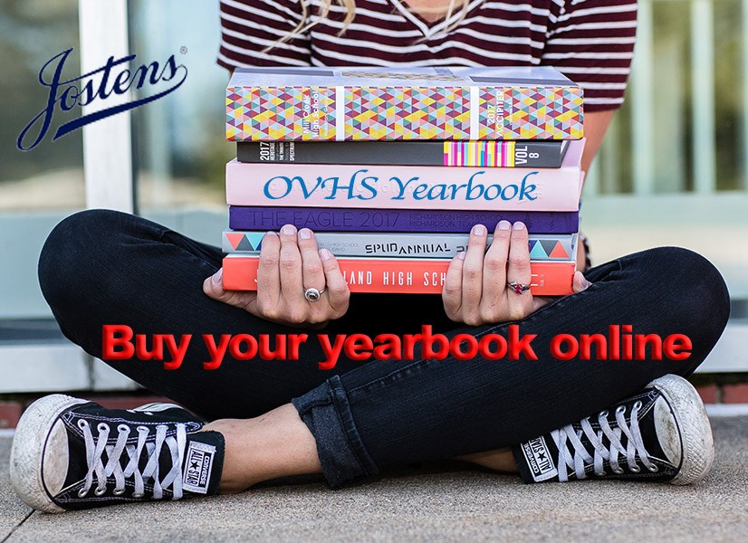 Person holding yearbooks