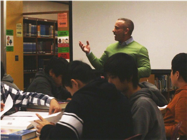 Mr. Hummel leads a class discussion.