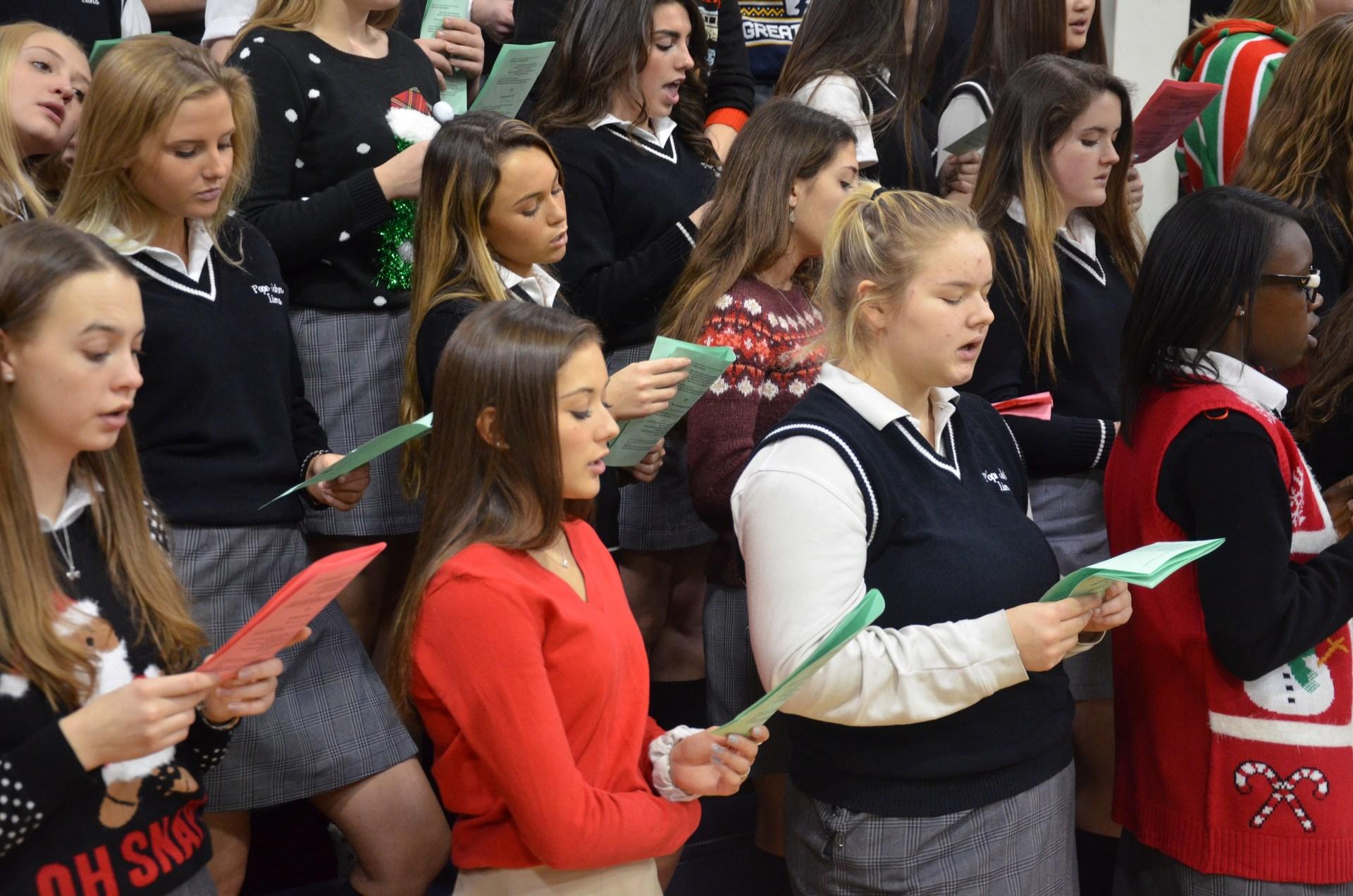Students singing a song at Christmas mass