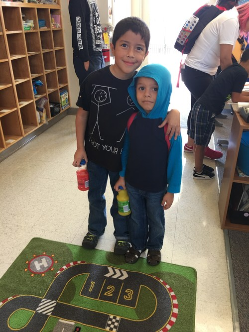 Big brother with little brother at the Kindergarten Tea