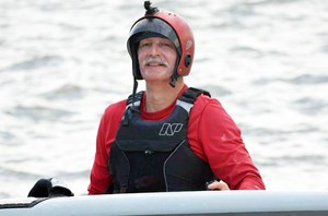 Jimmy wearing a helmet while board sailing.