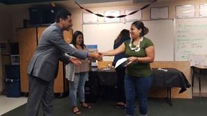 Superintendent Cruz congratulating a graduating parent