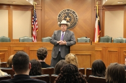 State Rep Bell speaking in front of MISD leadership group.jpg