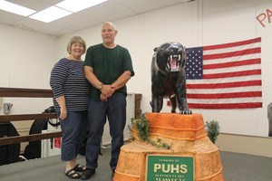 Jackie and Jeff Jones with the panther that Jeff carved and donated.
