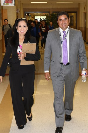 Ricardo Rodriguez walks to the next assignment with principal at R. Cantu Jr. High