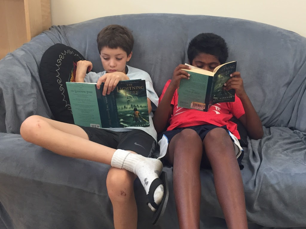 Upper El boys reading on couch