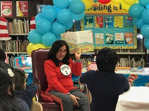 Author Jullia Torres Reading a Dr. Seuss story to the children