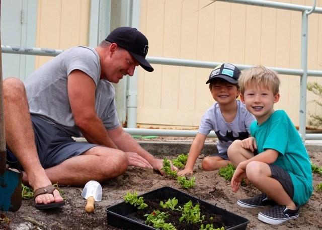 Father and children gardening