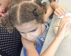 Student working on her sachet.