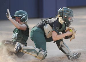 Coloma's Morgan Wagner tags out Napoleon's Dylan Wiley at home plate during a Division 3 quarterfinal Tuesday at Hope College.