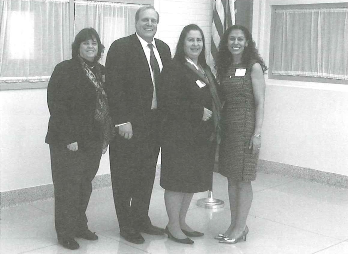 Photo of Principal Geri Perez, David Hespe, Silvia Abbato and Jeanette Pena receiving the National Blue Ribbon for Wilson School