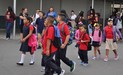 "Elwin Elementary students ""walk and talk"" before school to catch up with friends."