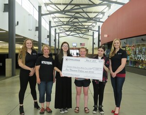 TKHS Robotics Team receives a $1,000 sponsorship check from Challenge Manufacturing.