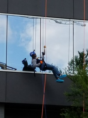 MISD Superintendent Dr Avery rappelling down the W Hotel.=