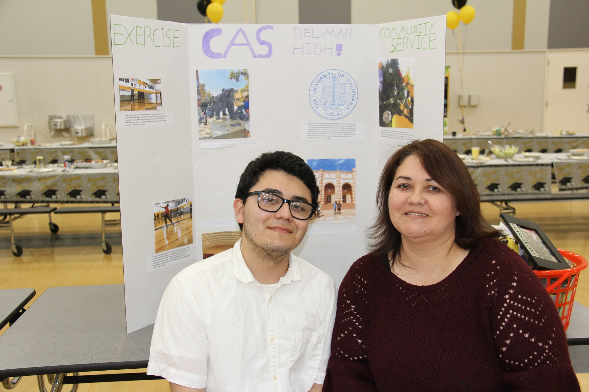 Image of IB Diploma Candidate with his presentation board at CAS Celebration Event