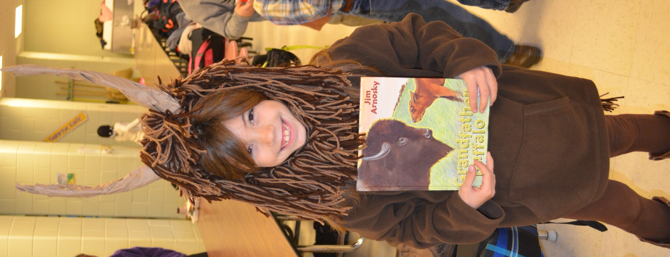 BES student dresses as a bufflo to depict the main character in her book, Grandfather's Buffalo.