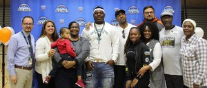 Elijah Chambers poses with family, coaches, and school staff.